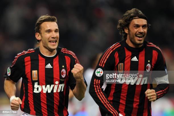 AC Milan's Ukrainian forward Andriy Shevchenko and AC Milan's defender and captain Paolo Maldini celebrate after AC Milan's Brazilian midfielder Kaka...