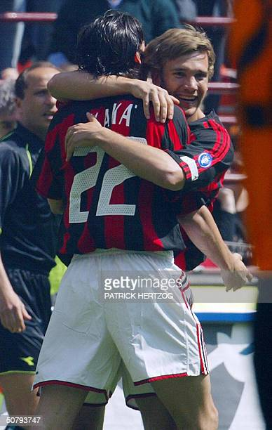 Milan's Ukrainian forward Andriy Shevchenko is congratulated by Brazilian teammate Kaka after scoring the first goal for his team against AS Roma...