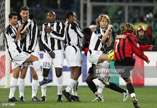 Milan's Ukrainian forward Andriy Shevchenko shoots a freekick against Juventus during their Italian serie A football match at delle Alpi stadium in...