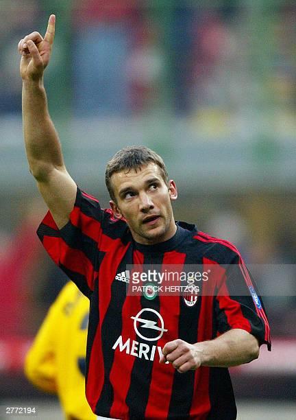 Milan's Ukrainian striker Andrey Shevchenko raises his hand after scoring against Modena 30 November 2003 at the San Siro stadium in Milan during...