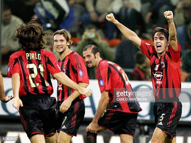 Milan's Ukrainian striker Andrij Schev celebrates with his teammates Alessandro Costacurta and Andrea Pirlo after scoring against Sampdoria during...