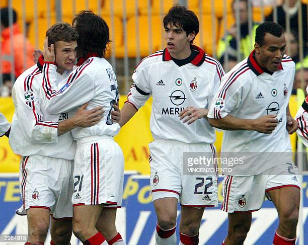 Milan's Ukrainian striker Andriy Shevchenko celebrates with his teammates Andrea Pirlo Ricardo Kaka and Cafu after scoring against Lecce during their...