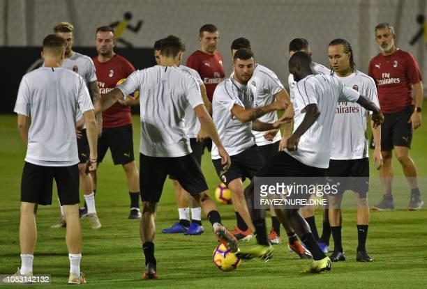 AC Milan's Uruguayan midfielder Diego Laxalt watches AC Milan's Italian forward Patrick Cutrone and teammates during training at the King Abdullah...