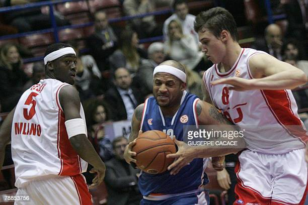Milan's US player Ansu Sesay and Milan's player Danilo Gallinari fights for the ball with Zagreb's player Larry Ayuso during their Euroleague group B...