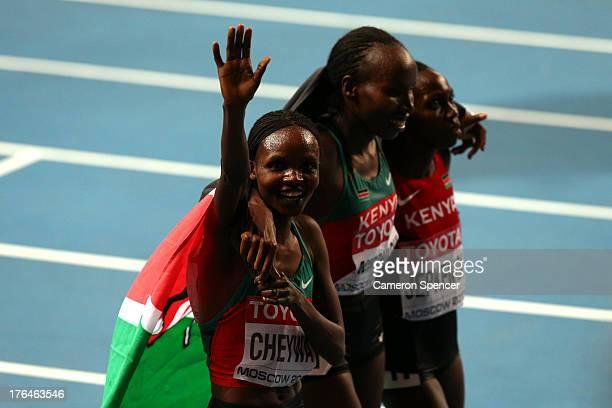 Milcah Chemos Cheywa of Kenya celebrates winning gold with silver medalist Lydia Chepkurui of Kenya and Hyvin Kiyeng Jepkemoi of Kenya in the Women's...