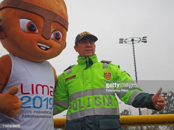 Milco the mascot of the games and the General PNP Alejandro Lam fingers up when the Directorate of Traffic Transportation and Road Safety of the...