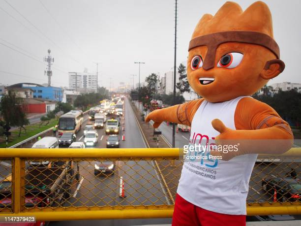 Milco the mascot of the games pointing the highway when the Directorate of Traffic Transportation and Road Safety of the Peruvian National Police...