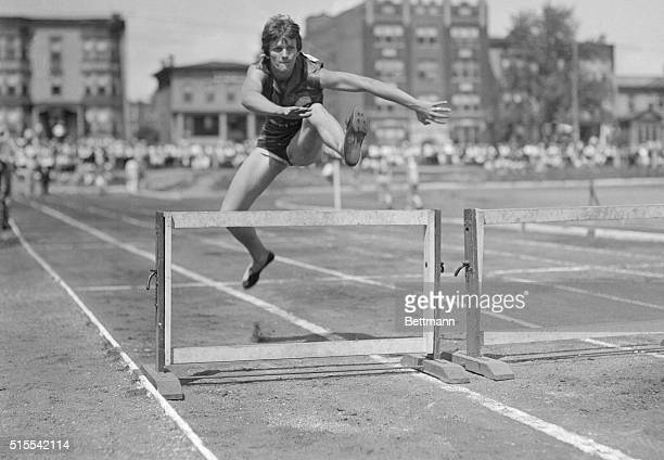 Mildred 'Babe' Didrickson smashed hurdle records as she flew over the timber when this photo was made during the Women's National Track Championships...