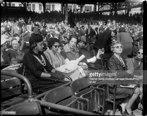 Mildred Baker Ella Baker Kay Jones and Carrie Stevens in stands at opening game of 1960 World Series Forbes Field Pittsburgh Pennsylvania October 5...