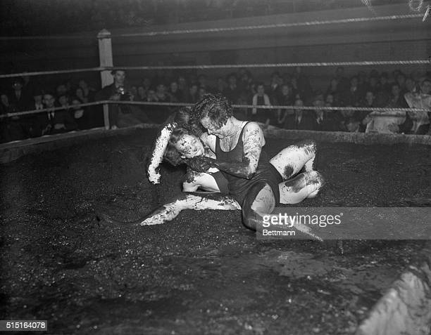 Mildred Burke claimant to the world's women's wrestling championship and Leona Gordon getting down to the dirty work in their hindustyle wrestling...