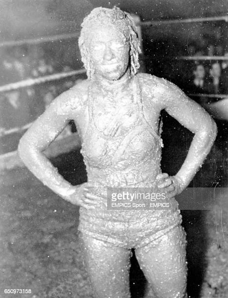 Mildred Burke of Kansas City Missouri claimant to the women's wrestling championship of the world and Leona Gordon of Chicago gave each other a mud...