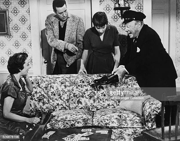 Mildred Natwick John Forsythe Shirley MacLaine and Edmund Gwenn in a scene from the 1955 Alfred Hitchcock film The Trouble with Harry