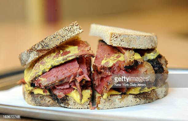 Mile End Deli Sandwich shop on Bond St in Brooklyn where they make Montrealstyle Jewish food and their signature sandwich is smoked meat on rye