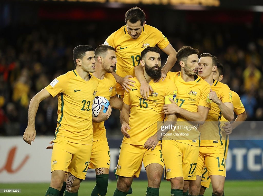 Mile Jaedinak of Australia celebrates with team mates after scoring a penalty during the 2018 FIFA World Cup Qualifier match between the Australian Socceroos and Japan at Etihad Stadium on October 11, 2016 in Melbourne, Australia.