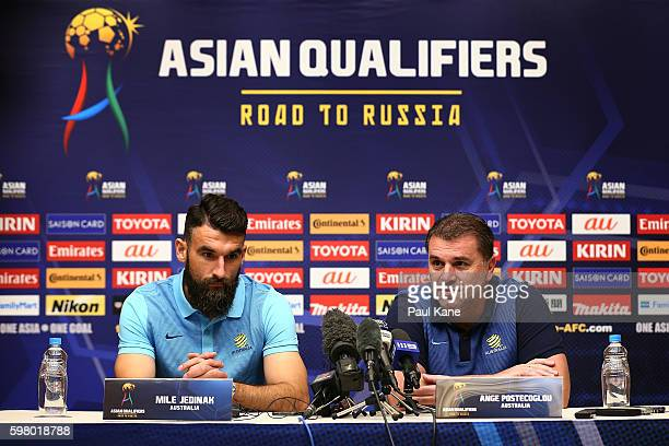 Mile Jedinak and Ange Postecoglou of Australia address the media during an Australian Socceroos prematch media conference at the Hyatt Regency on...
