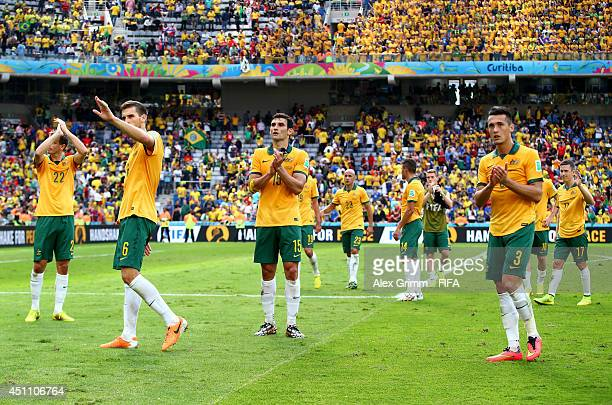 Mile Jedinak and Australia players acknowledge the fans after the 03 defeat in the 2014 FIFA World Cup Brazil Group B match between Australia and...