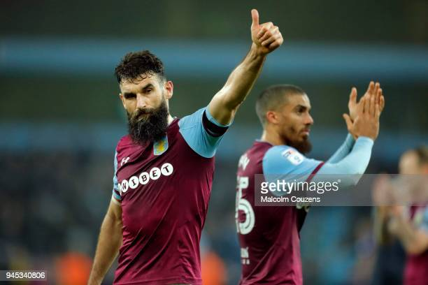 Mile Jedinak and Lewis Grabban of Aston Villa applaud the supporters following the Sky Bet Championship match between Aston Villa and Cardiff City at...
