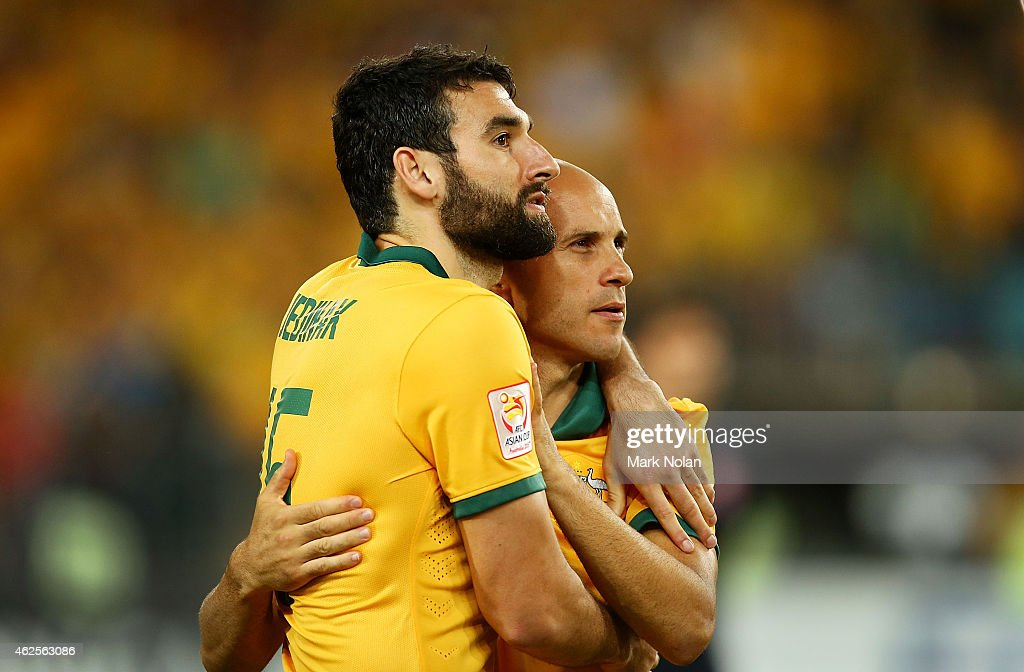 Mile Jedinak and Mark Bresciano of Australia embrace after winning the 2015 Asian Cup final match between Korea Republic and the Australian Socceroos at ANZ Stadium on January 31, 2015 in Sydney, Australia.