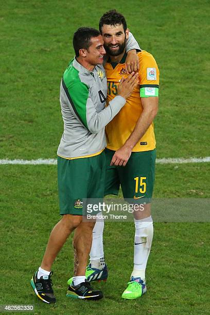 Mile Jedinak and Tim Cahill of Australia embrace at full time after victory over Korea Republic following the 2015 Asian Cup final match between...