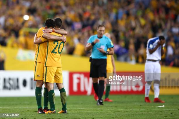 Mile Jedinak and Trent Sainsbury of Australia celebrate victory during the 2018 FIFA World Cup Qualifiers Leg 2 match between the Australian...