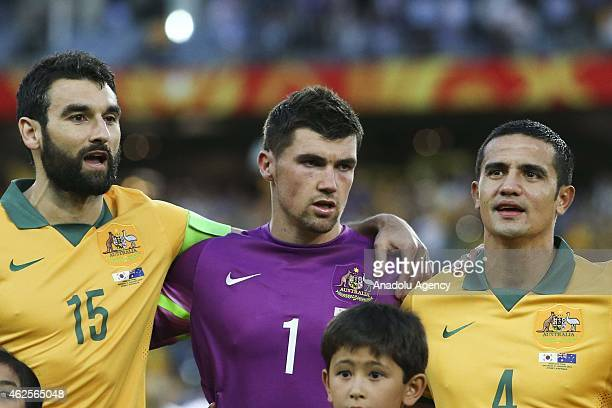 Mile Jedinak Mathew Ryan and Tim Cahill of Australia sing the Australian national anthem prior to the 2015 Asia Cup Final between Australia Vs South...
