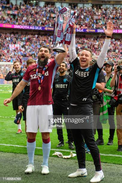 Mile Jedinak of Aston Villa and Aston Villa's John Terry celebrate with the trophy during the Sky Bet Championship match between Aston Villa and...