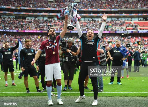 Mile Jedinak of Aston Villa and John Terry, Aston Villa Assistant Head Coach celebrate with the Sky Bet Championship Play-off Final Trophy following...