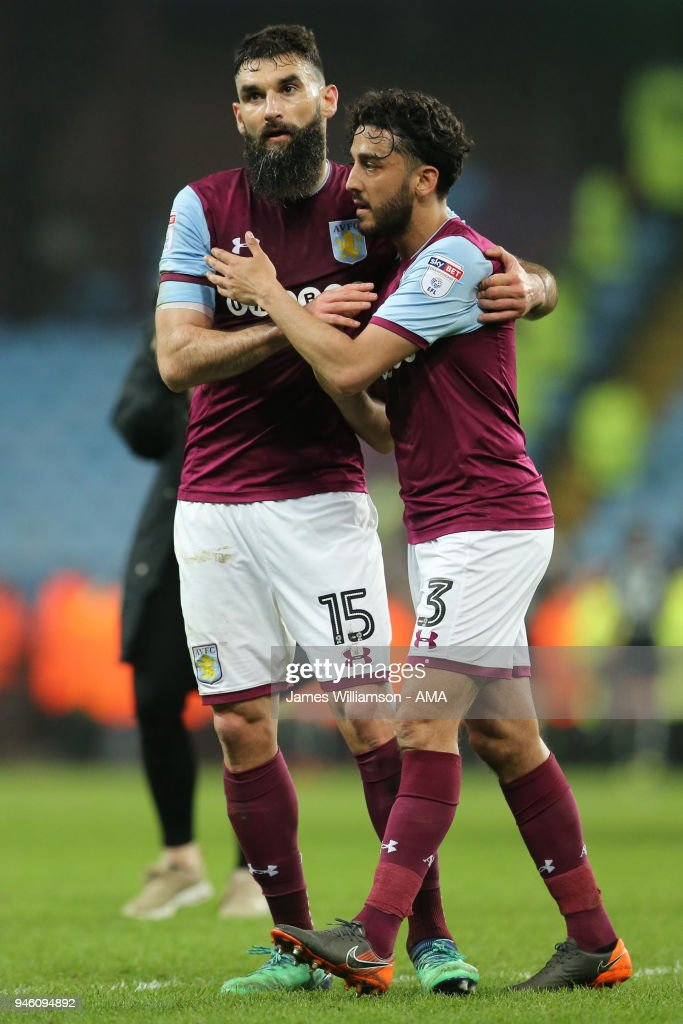 Mile Jedinak of Aston Villa and Neil Taylor of Aston Villa during the Sky Bet Championship match between Aston Villa and Leeds United at Villa Park on April 13, 2018 in Birmingham, England.