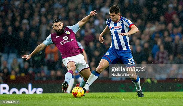 Mile Jedinak of Aston Villa ash challenged by Yanic Wildschut of Wigan Athletic during the Sky Bet Championship match between Aston Villa and Wigan...