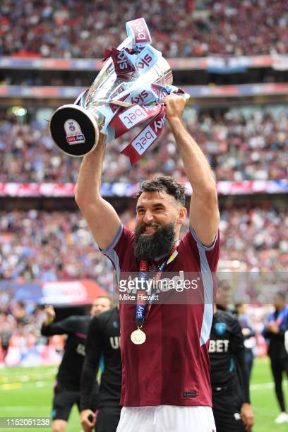 Mile Jedinak of Aston Villa celebrates after the Sky Bet Championship Play-off Final match between Aston Villa and Derby County at Wembley Stadium on...