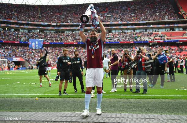 Mile Jedinak of Aston Villa celebrates with the Sky Bet Championship Play-off Final Trophy following his team's victory in the Sky Bet Championship...