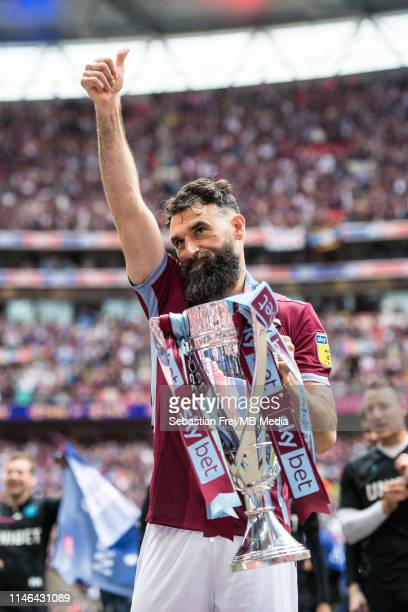 Mile Jedinak of Aston Villa celebrates with the trophy after the Sky Bet Championship Play-off Final match between Aston Villa and Derby County at...