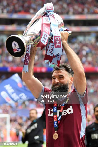 Mile Jedinak of Aston Villa celebrates with the trophy following victory in the Sky Bet Championship Play-off Final match between Aston Villa and...