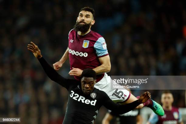 Mile Jedinak of Aston Villa competes with Caleb Ekuban of Leeds United during the Sky Bet Championship match between Aston Villa and Leeds United at...