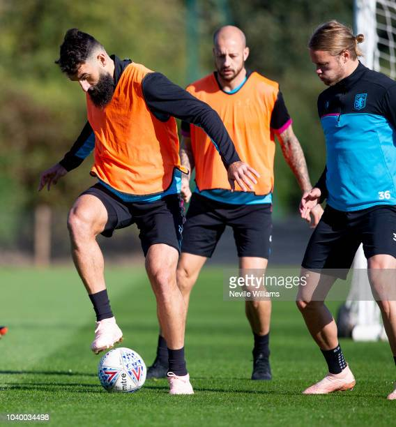 Mile Jedinak of Aston Villa in action during a training session at the club's training ground at Bodymoor Heath on September 25, 2018 in Birmingham,...