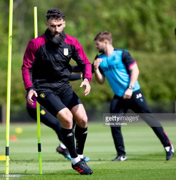 Mile Jedinak of Aston Villa in action during a training session at Aston Villa's Bodymoor Heath training ground on May 07, 2019 in Birmingham,...