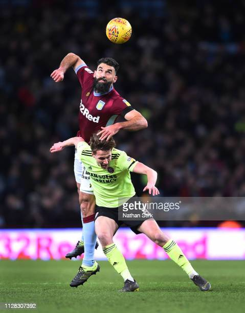 Mile Jedinak of Aston Villa in action with Kieran Dowell of Sheffield United during the Sky Bet Championship match between Aston Villa and Sheffield...