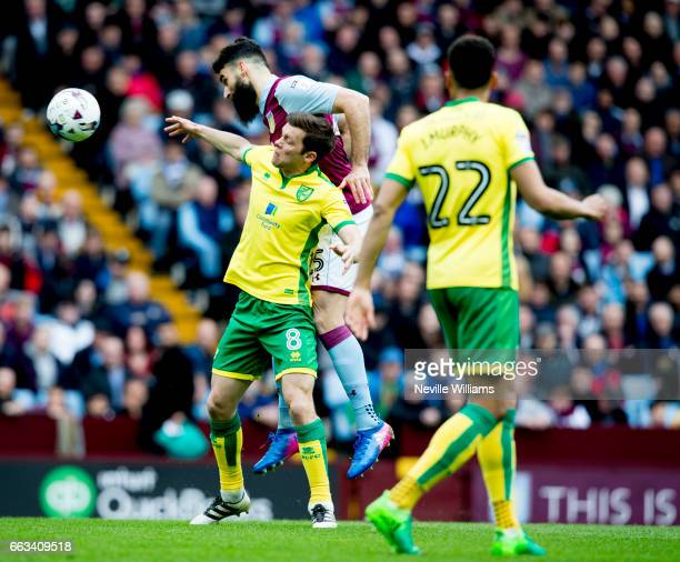 Mile Jedinak of Aston Villa is challenged by Jonny Howson of Norwich City during the Sky Bet Championship match between Aston Villa and Norwich City...