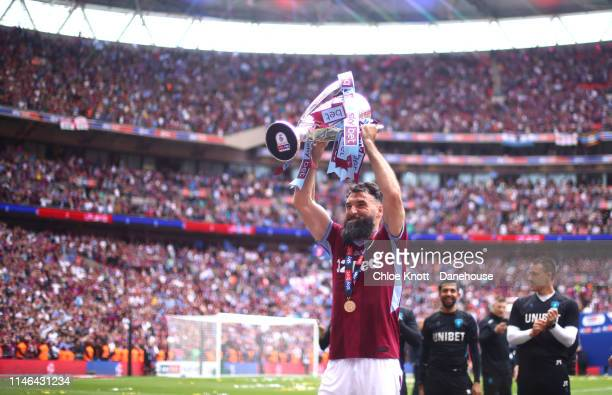 Mile Jedinak of Aston Villa lift the cup after winning the Sky Bet Championship Play-Off Final match between Aston Villa and Derby County at Wembley...