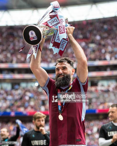Mile Jedinak of Aston Villa lift the trophy after the Sky Bet Championship Play-off Final match between Aston Villa and Derby County at Wembley...