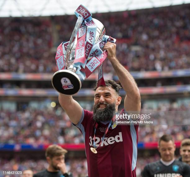Mile Jedinak of Aston Villa lifts the trophy during the Sky Bet Championship Play-off Final match between Aston Villa and Derby County at Wembley...