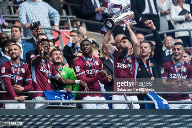 Mile Jedinak of Aston Villa lifts trophy during the Sky Bet Championship Play-off Final match between Aston Villa and Derby County at Wembley Stadium...