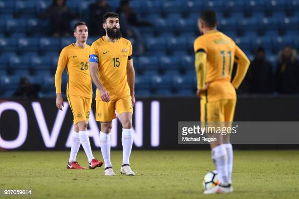 Mile Jedinak of Australia and Aleksandar Susnjar of Australia look on after conceeding the third goal during the International Friendly match between...