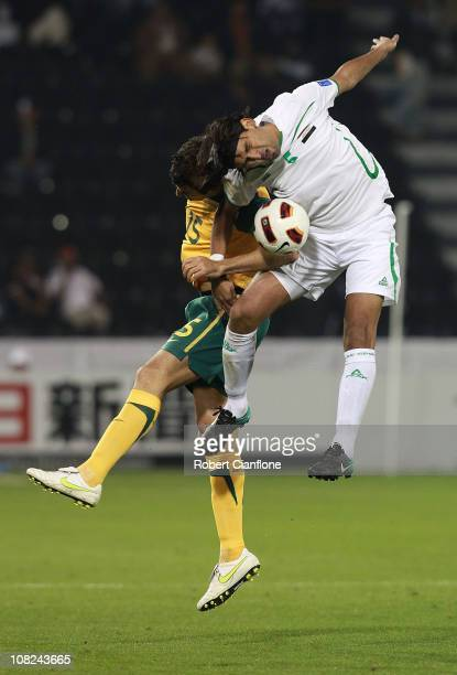 Mile Jedinak of Australia and Nashat Akram of Iraq challenge each other for the ball during the AFC Asian Cup quarter final match between the...