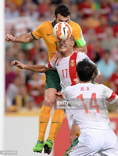 Mile Jedinak of Australia and Zhang Chengdong of China challenge for the ball during the 2015 Asian Cup match between China PR and the Australian...