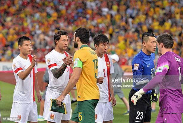 Mile Jedinak of Australia and Zhang Linpeng of China shake hands before the 2015 Asian Cup match between China PR and the Australian Socceroos at...