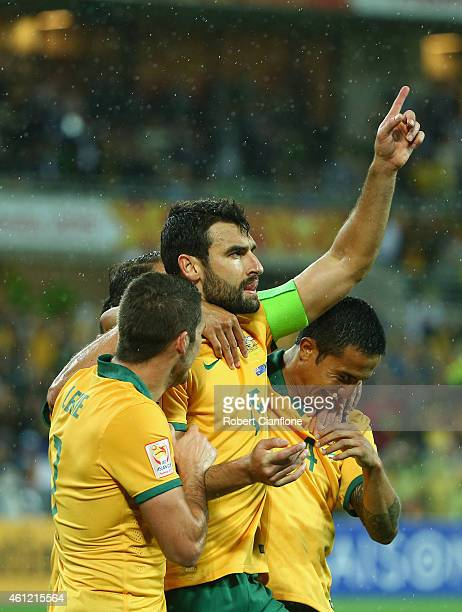 Mile Jedinak of Australia celebrates after he scored a penalty during the 2015 Asian Cup match between the Australian Socceroos and Kuwait at AAMI...