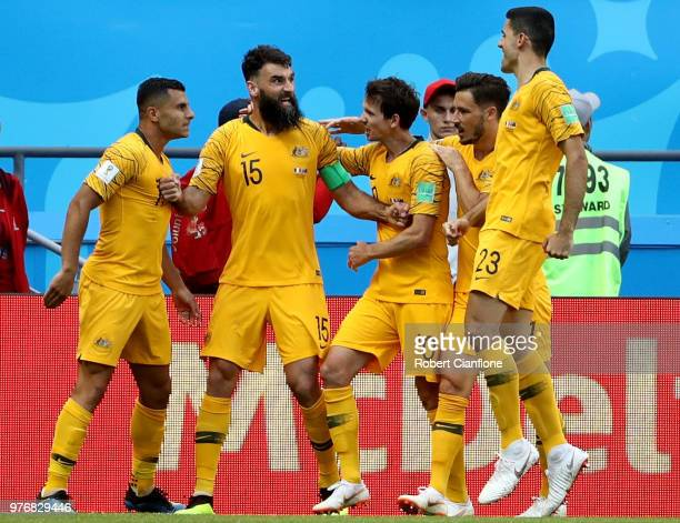 Mile Jedinak of Australia celebrates after scoring his team's first goal from a penalty with team mates during the 2018 FIFA World Cup Russia group C...