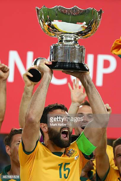 Mile Jedinak of Australia celebrates as he lifts the trophy after victory during the 2015 Asian Cup final match between Korea Republic and the...