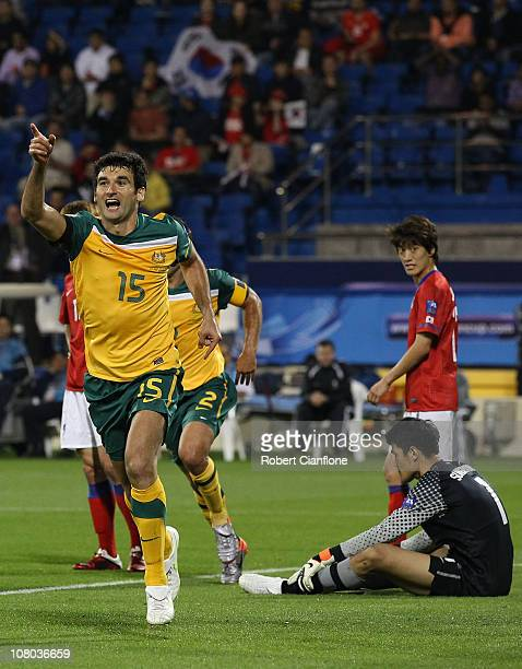 Mile Jedinak of Australia celebrates his goal during the AFC Asian Cup Group C match between the Australian Socceroos and Korea Republic at...